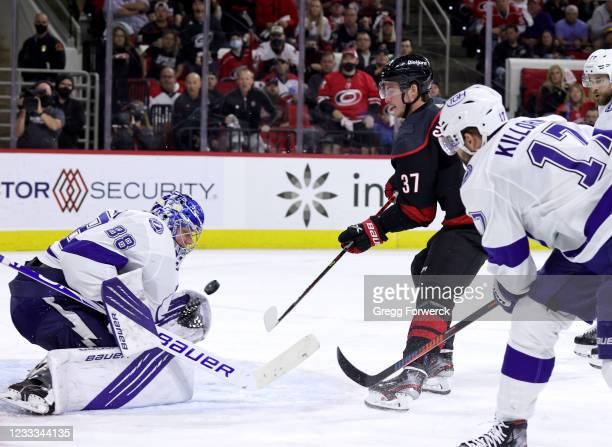Andrei Vasilevskiy of the Tampa Bay Lightning goes down in the crease to make a save on a shot by Andrei Svechnikov of the Carolina Hurricanes in...