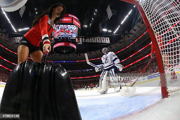 Andrei Vasilevskiy of the Tampa Bay Lightning looks on as members of the Chicago Blackhawks ice crew clear the crease during Game Four of the 2015...