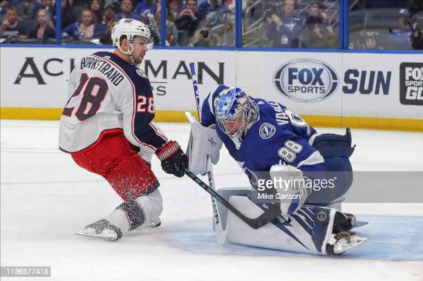 Andrei Vasilevskiy of the Tampa Bay Lightning makes a save against Oliver Bjorkstrand of the Columbus Blue Jackets during the first period in Game...