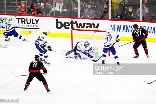 Andrei Vasilevskiy of the Tampa Bay Lightning makes a save against Andrei Svechnikov of the Carolina Hurricanes during the second period in Game Five...