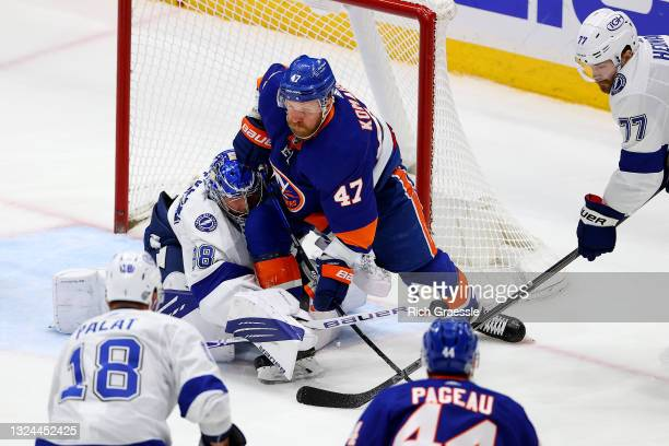 Andrei Vasilevskiy of the Tampa Bay Lightning makes a save against Leo Komarov of the New York Islanders during the first period in Game Four of the...