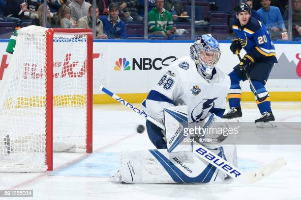 Andrei Vasilevskiy of the Tampa Bay Lightning makes a save against the St Louis Blues at Scottrade Center on December 12 2017 in St Louis Missouri