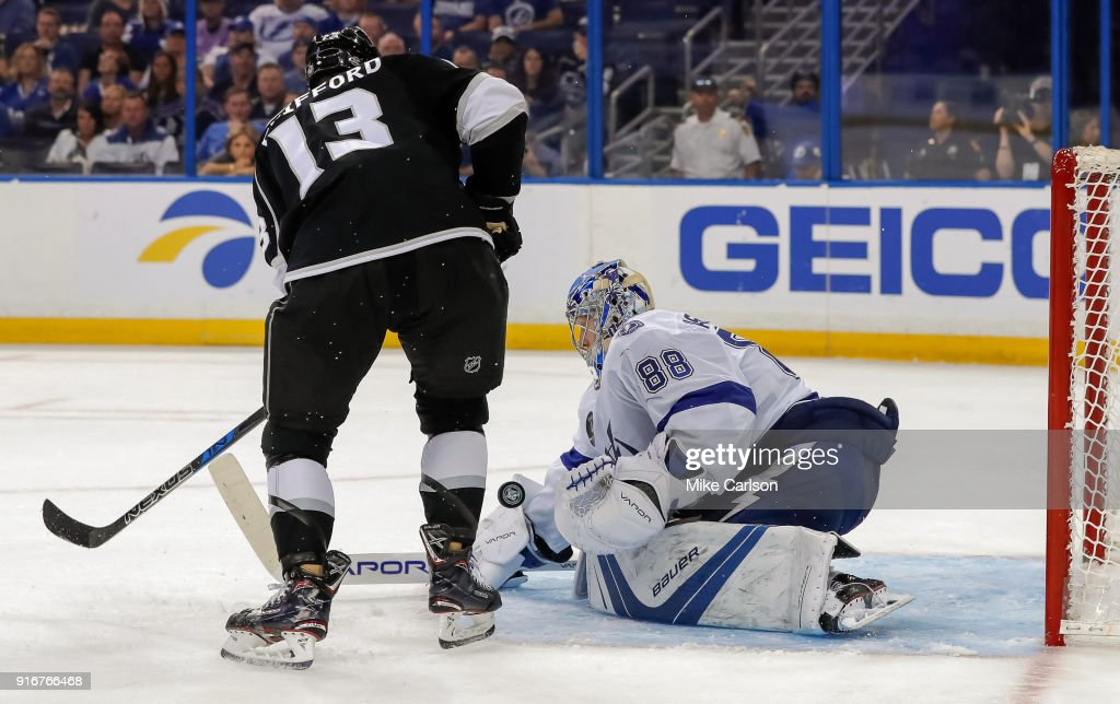 Andrei Vasilevskiy #88 of the Tampa Bay Lightning makes a save against Kyle Clifford #13 of the Los Angeles Kings at the Amalie Arena on February 10, 2018 in Tampa, Florida.