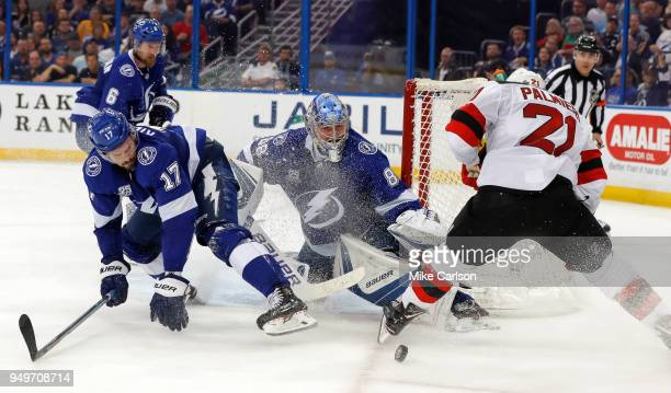 Andrei Vasilevskiy of the Tampa Bay Lightning makes a save against Kyle Palmieri of the New Jersey Devils as Alex Killorn defends in the third period...