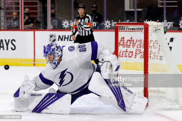 Andrei Vasilevskiy of the Tampa Bay Lightning makes a save during the first period of their game against the Carolina Hurricanes at PNC Arena on...