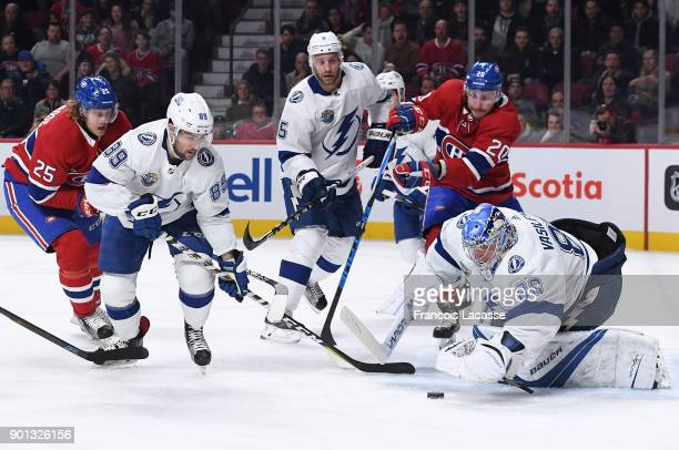 Andrei Vasilevskiy of the Tampa Bay Lightning makes a save in front of Nicolas Deslauriers of the Montreal Canadiens in the NHL game at the Bell...