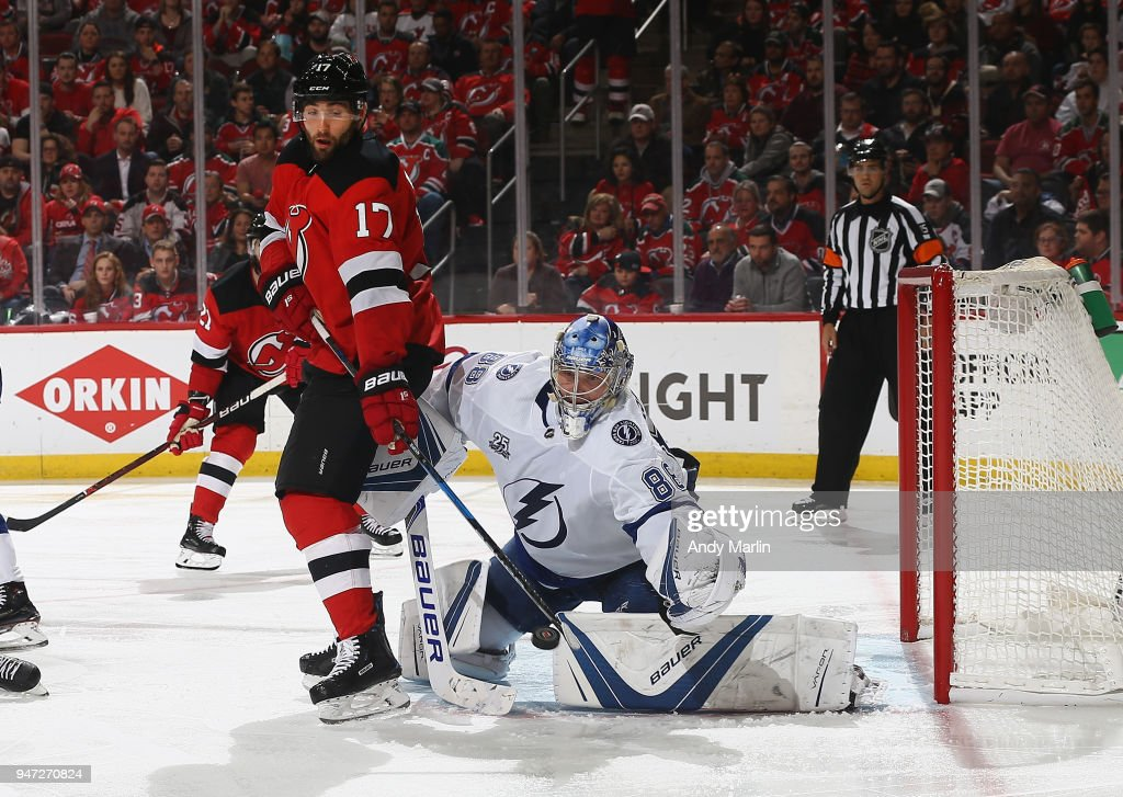 Andrei Vasilevskiy #88 of the Tampa Bay Lightning makes a save on a deflection by Patrick Maroon #17 of the New Jersey Devils in Game Three of the Eastern Conference First Round during the 2018 NHL Stanley Cup Playoffs at Prudential Center on April 16, 2018 in Newark, New Jersey.