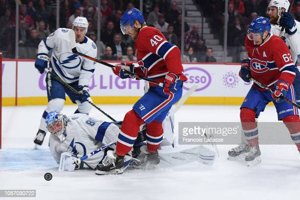 Andrei Vasilevskiy of the Tampa Bay Lightning makes a save on a shot by Joel Armia of the Montreal Canadiens in the NHL game at the Bell Centre on...
