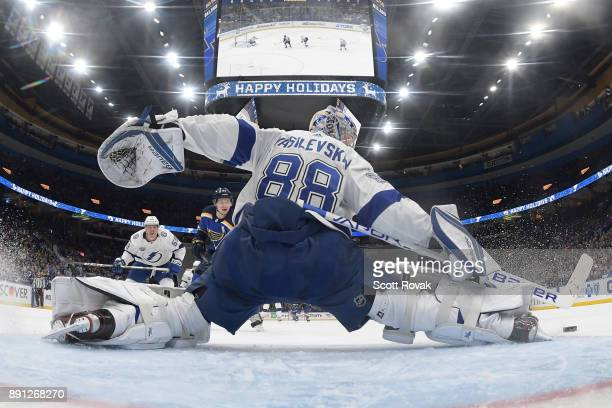 Andrei Vasilevskiy of the Tampa Bay Lightning makes a save on a shot by Vladimir Tarasenko of the St Louis Blues at Scottrade Center on December 12...