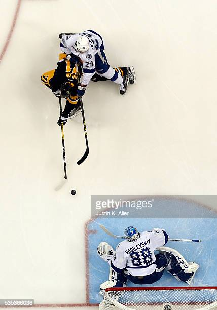 Andrei Vasilevskiy of the Tampa Bay Lightning makes a save on Evgeni Malkin of the Pittsburgh Penguins in Game Seven of the Eastern Conference Final...