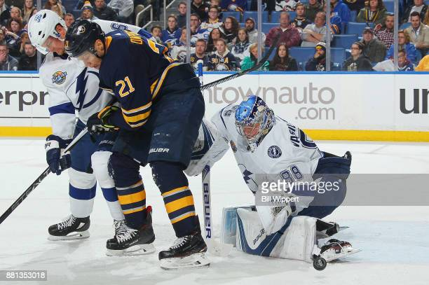 Andrei Vasilevskiy of the Tampa Bay Lightning makes a third period save as Anton Stralman defends against Kyle Okposo of the Buffalo Sabres on...