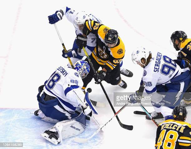 Andrei Vasilevskiy of the Tampa Bay Lightning makes the first period stop on Brad Marchand of the Boston Bruins in an Eastern Conference Round Robin...