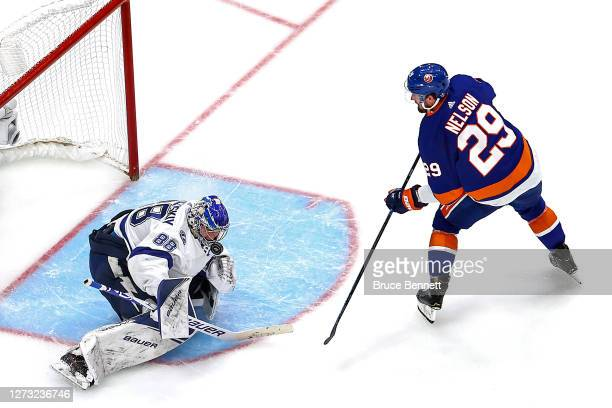 Andrei Vasilevskiy of the Tampa Bay Lightning makes the save on a breakaway by Brock Nelson of the New York Islanders during the first overtime...