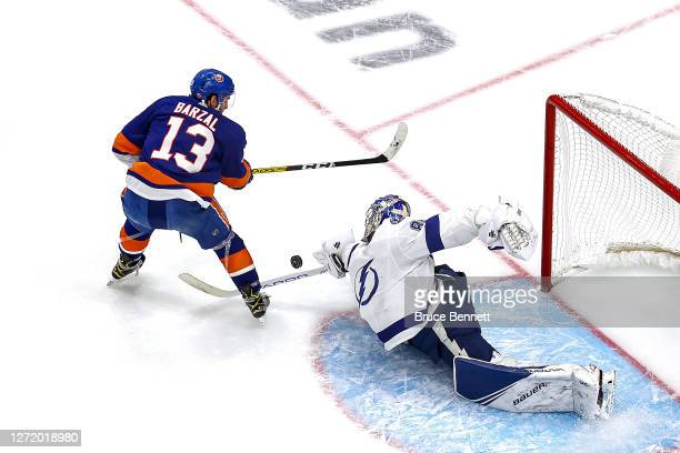 Andrei Vasilevskiy of the Tampa Bay Lightning makes the save on a breakaway shot attempt by Mathew Barzal of the New York Islanders during the first...