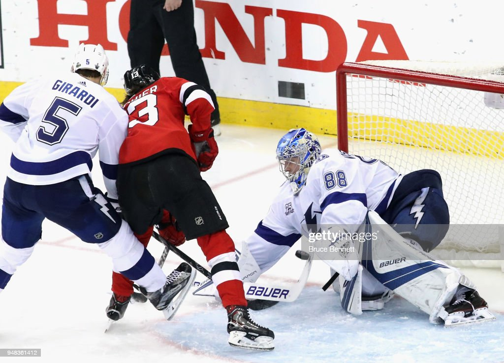 Andrei Vasilevskiy #88 of the Tampa Bay Lightning makes the stick save on Nico Hischier #13 of the New Jersey Devils in Game Four of the Eastern Conference First Round during the 2018 NHL Stanley Cup Playoffs at the Prudential Center on April 18, 2018 in Newark, New Jersey. The Lightning defeated the Devils 3-1.