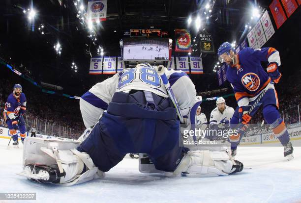 Andrei Vasilevskiy of the Tampa Bay Lightning makes the stop on Travis Zajac of the New York Islanders in Game Six of the NHL Stanley Cup Semifinals...