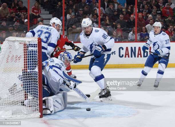 Andrei Vasilevskiy of the Tampa Bay Lightning reaches for a loose puck with teammate Erik Cernak looking on against the Ottawa Senators at Canadian...