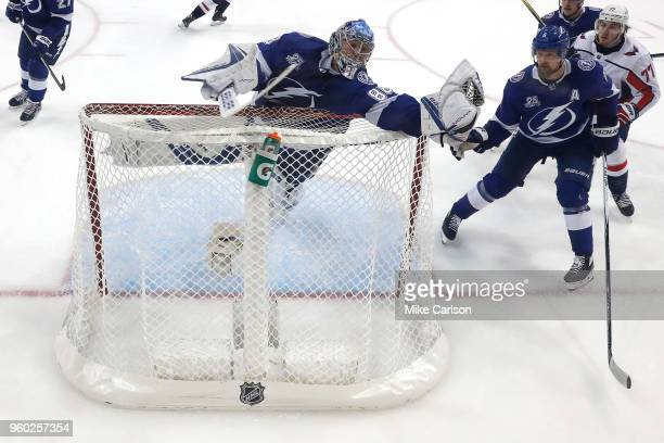 Andrei Vasilevskiy of the Tampa Bay Lightning reaches over the net to make a save against the Washington Capitals during the second period in Game...