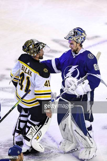 Andrei Vasilevskiy of the Tampa Bay Lightning shakes hands with Jaroslav Halak of the Boston Bruins after the Lightning's 32 victory during the...