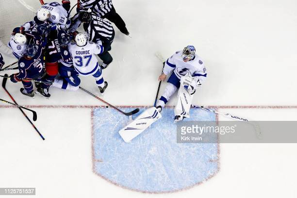 Andrei Vasilevskiy of the Tampa Bay Lightning sits on the ice after being knocked down by Josh Anderson of the Columbus Blue Jackets on February 18...