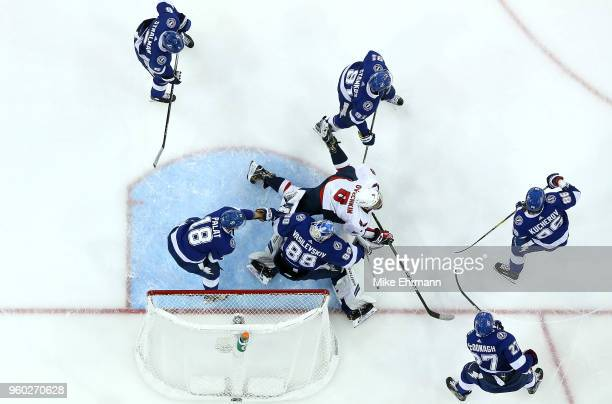 Andrei Vasilevskiy of the Tampa Bay Lightning stops a shot from Alex Ovechkin of the Washington Capitals in Game Five of the Eastern Conference...