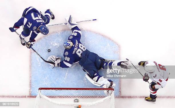 Andrei Vasilevskiy of the Tampa Bay Lightning stops a shot from Alex Ovechkin of the Washington Capitals in Game Seven of the Eastern Conference...