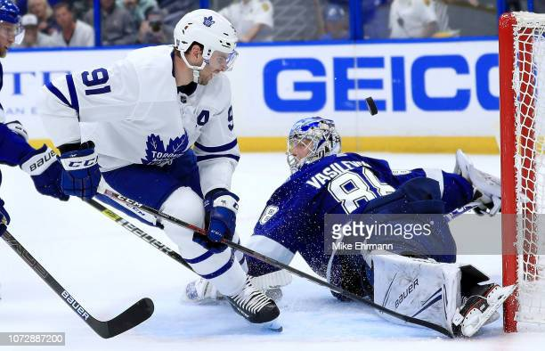 Andrei Vasilevskiy of the Tampa Bay Lightning stops a shot from John Tavares of the Toronto Maple Leafs during a game at Amalie Arena on December 13...