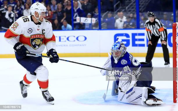 Andrei Vasilevskiy of the Tampa Bay Lightning stops a shot from Aleksander Barkov of the Florida Panthers during Opening Night at Amalie Arena on...