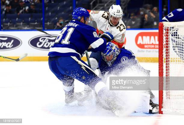 Andrei Vasilevskiy of the Tampa Bay Lightning stops a shot from Carter Verhaeghe of the Florida Panthers during Game Three of the First Round of the...