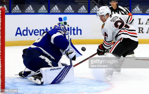 Andrei Vasilevskiy of the Tampa Bay Lightning stops a shot from Pius Suter of the Chicago Blackhawks during a game on opening night of the 2020-21...