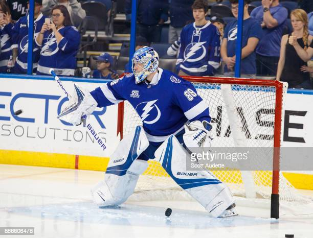 Andrei Vasilevskiy of the Tampa Bay Lightning warms up before the game against the New York Islanders during pregame at Amalie Arena on December 5...