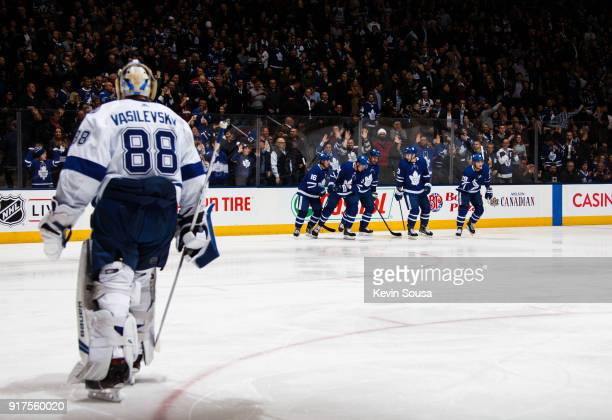 Andrei Vasilevskiy of the Tampa Bay Lightning watches as William Nylander of the Toronto Maple Leafs and his teammates celebrate Nylander's second...