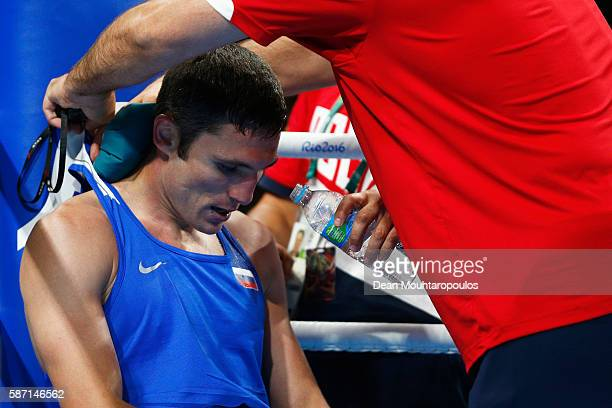 Andrei Zamkovoi of Russia is cooled by his corner against Rayton Nduku Okwiri of Kenya as they compete in the Men's Welter 69kg preliminary bout on...