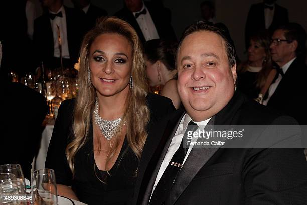 Andreia and Hugo Salomone attend the 5th Annual amfAR Inspiration Gala at the home of Dinho Diniz on April 10 2015 in Sao Paulo Brazil