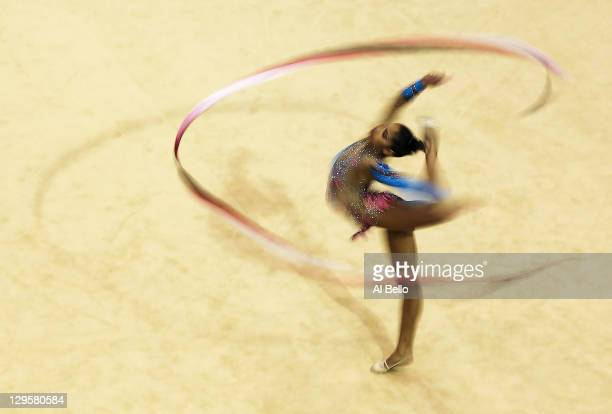 Andreina Acevedo of Venezuela performs with her ribbon at the Rhythmic Gymnastic finals during Day Four of the XVI Pan American Games at the Nissan...
