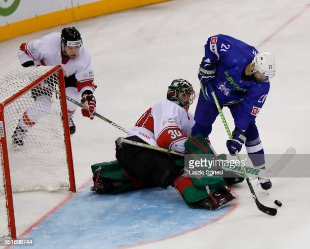 Andrej Hebar of Slovenia, Adam Vay of Hungary and Zsombor Garat of Hungary in action during the 2018 IIHF Ice Hockey World Championship Division I...