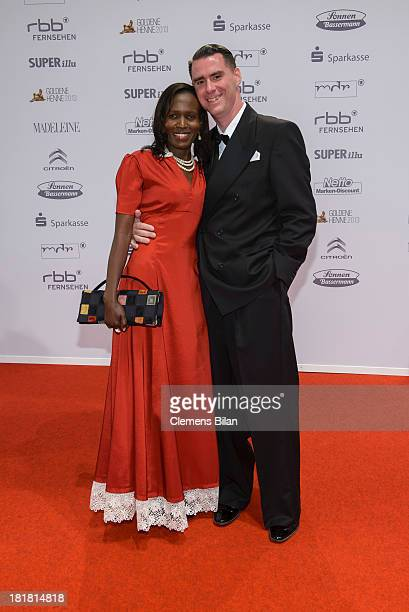 Andrej Hermlin and his wife Joyce arrives for the Goldene Henne 2013 award at Stage Theater on September 25 2013 in Berlin Germany