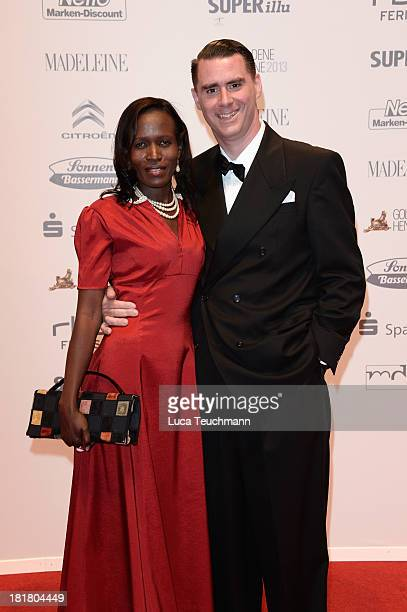 Andrej Hermlin and partner Joyce attend the Goldene Henne 2013 at Stage Theater on September 25 2013 in Berlin Germany