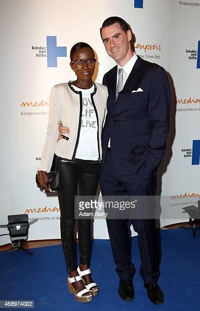 Andrej HermlinLeder and his wife Jocelyn arrive for the 16th Medienpreis der Kindernothilfe award ceremony on November 14 2014 in Berlin Germany