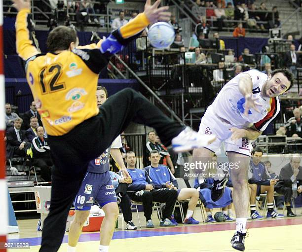 Andrej Klimovets of Germany competes with Gorazd Skof of Slovenia during the Handball Euro06 main round match between Slovenia and Germany on...
