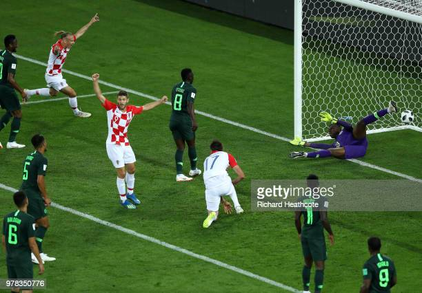 Andrej Kramaric Mario Mandzukic and Domagoj Vida of Croatia celebrate after Oghenekaro Etebo of Nigeria scores an own goal during the 2018 FIFA World...
