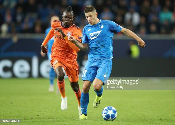 Andrej Kramaric of 1899 Hoffenheim breaks away from Bertrand Traore of Olympique Lyonnais during the Group F match of the UEFA Champions League...