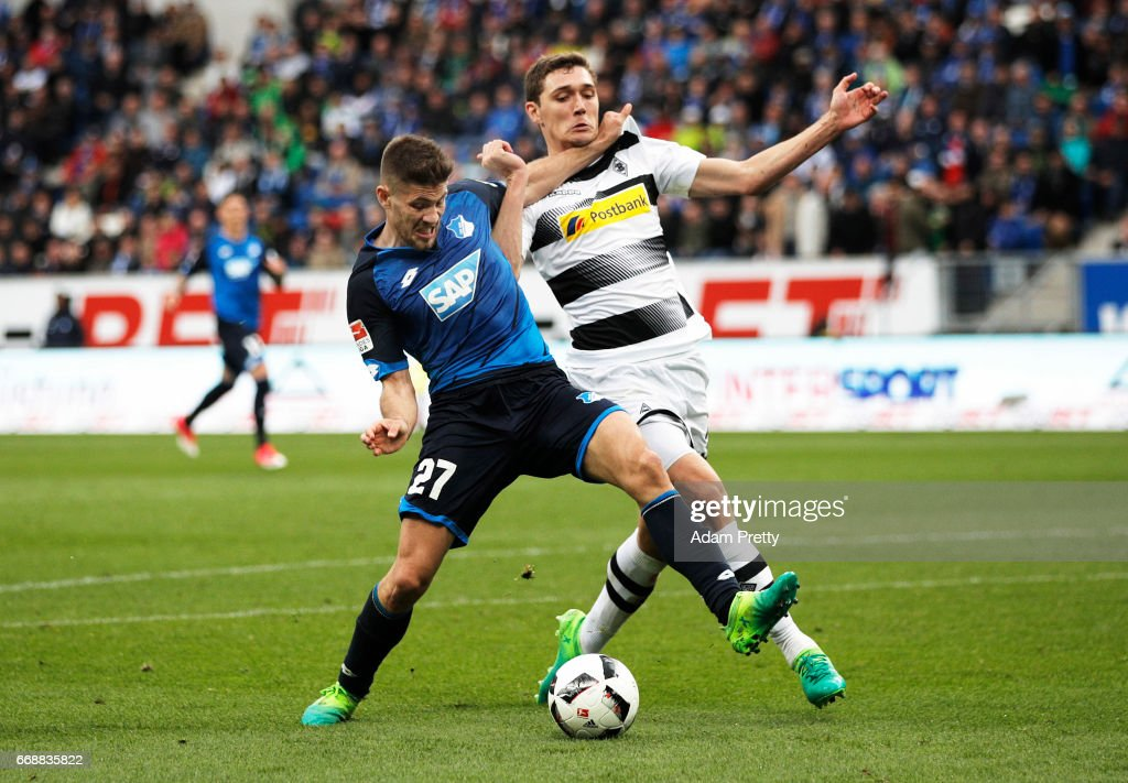 Andrej Kramaric of 1899 Hoffenheim is challenged by Andreas Christensen of Borussia Moenchengladbach during the Bundesliga match between TSG 1899 Hoffenheim and Borussia Moenchengladbach at Wirsol Rhein-Neckar-Arena on April 15, 2017 in Sinsheim, Germany.