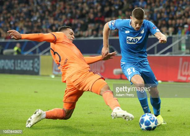 Andrej Kramaric of 1899 Hoffenheim is tackled by Kenny Tete of Olympique Lyonnais during the Group F match of the UEFA Champions League between TSG...