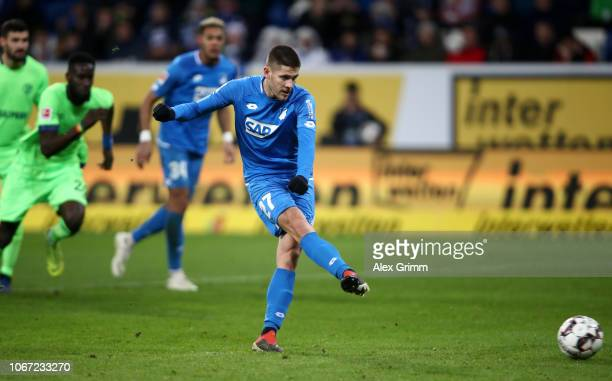 Andrej Kramaric of 1899 Hoffenheim scores a penalty for his team's first goal during the Bundesliga match between TSG 1899 Hoffenheim and FC Schalke...