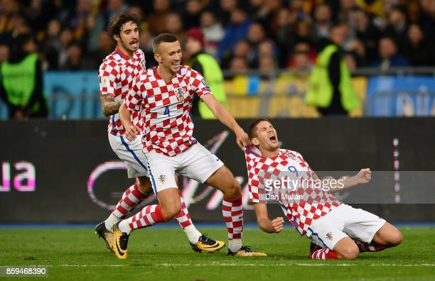 Andrej Kramaric of Croatia celebrates with Ivan Perisic and Sime Vrsaljko of Croatia as he scores their first goal during the FIFA 2018 World Cup...
