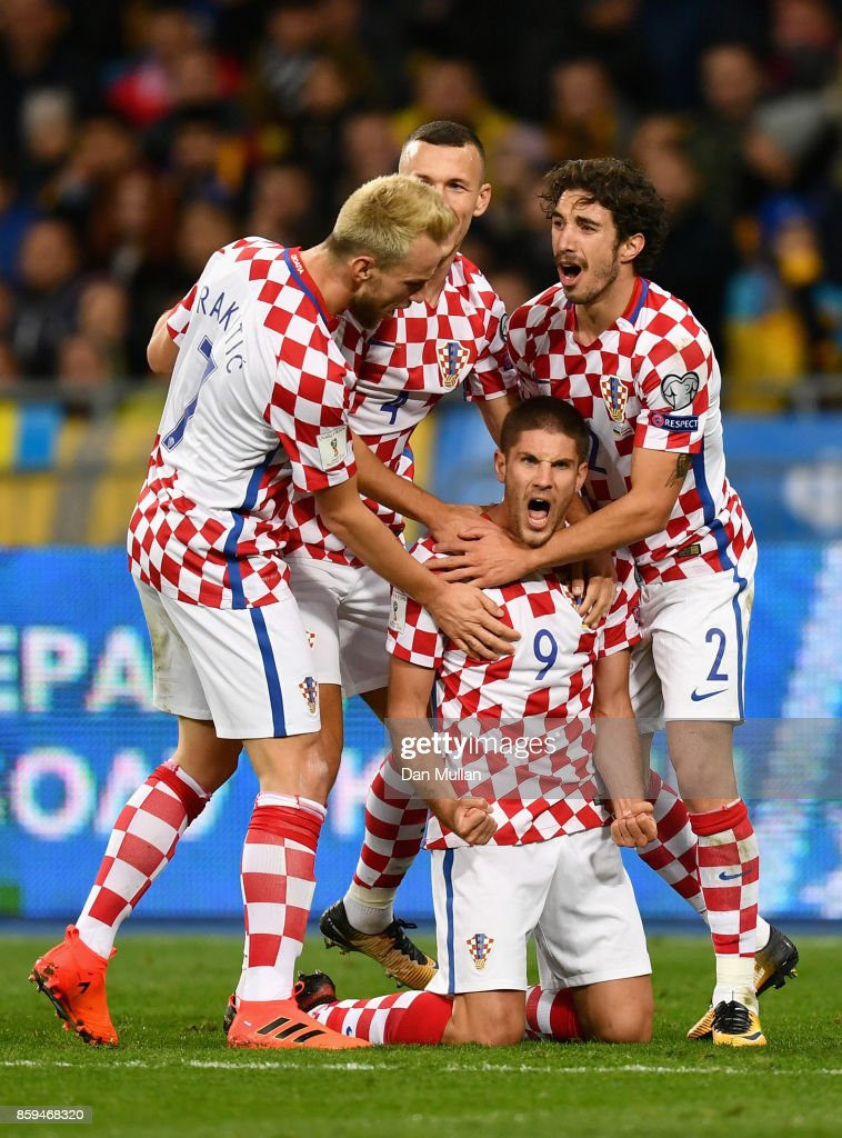Andrej Kramaric of Croatia (9) celebrates with team mates as he scores their first goal during the FIFA 2018 World Cup Group I Qualifier between Ukraine and Croatia at Kiev Olympic Stadium on October 9, 2017 in Kiev, Ukraine.