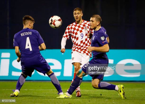Andrej Kramaric of Croatia in action against Panagiotis Retsos and Kyriakos Papadopoulos of Greece during the FIFA 2018 World Cup Qualifier PlayOff...
