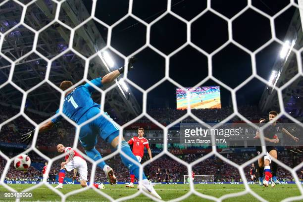 Andrej Kramaric of Croatia scores his team's first goal past Igor Akinfeev of Russia during the 2018 FIFA World Cup Russia Quarter Final match...