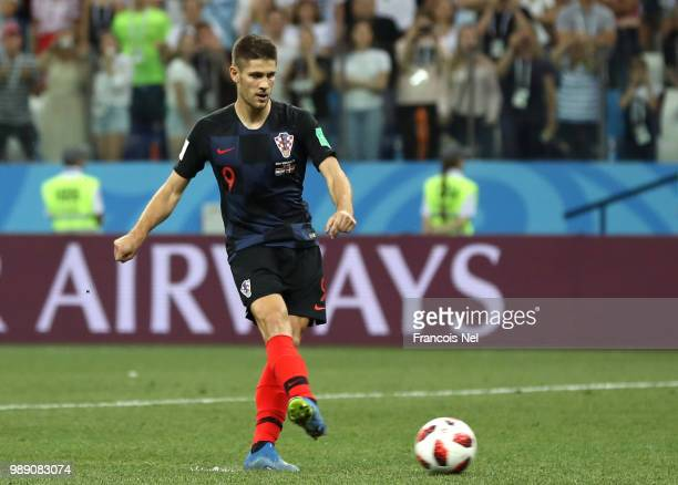 Andrej Kramaric of Croatia scores his team's second penalty in the penalty shoot out during the 2018 FIFA World Cup Russia Round of 16 match between...